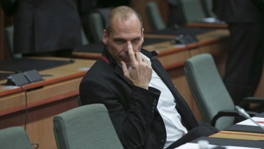 Greek Finance Minister Varoufakis waits for the start of an extraordinary euro zone Finance Ministers meeting to discuss Athens' plans to reverse austerity measures agreed as part of its bailout in Brussels